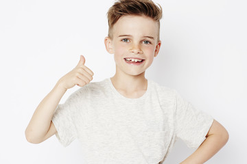 Young boy with thumbs up, portrait
