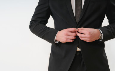 close up part of business man body side button up his black suit
