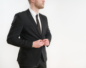 part of business man body side button up his black suit on white