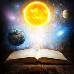 Wall Mural - Opened magic book with sun, earth, moon, saturn, stars and galaxy. Concept on the topic of astronomy or fantasy. Elements of this image furnished by NASA.