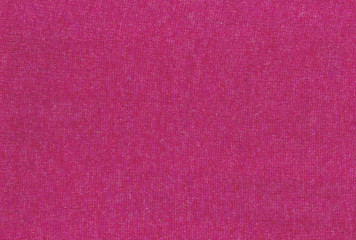 Pink knitted textile texture.