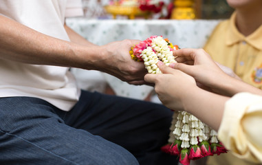 Daughter give jasmine garland to father in fathers day