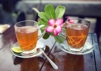 Two tea cups with frangipani flower on road cafe. Koh Samui island,Thailand