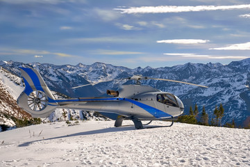 Helicopter landed on mountain Mamay near lake Baikal. View of the mountain range Khamar-Daban.