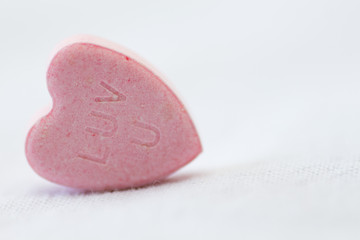pink valentine candy, love you on a white background