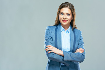 Smiling business woman portrait, crossed arms