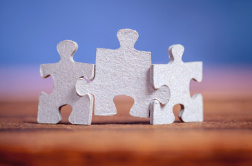 Three jigsaw puzzle pieces on a table