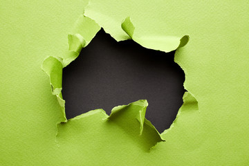 Torn green paper