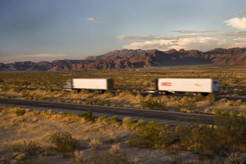 Blur of semi trailer truck at dusk, Arizona