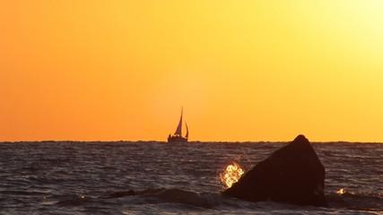 Sail silhouette on sunset/ Evening on black sea