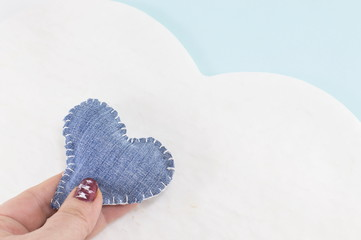 denim heart in woman's hands
