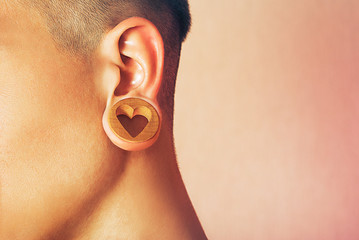 Man with earlobe hole.