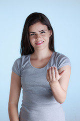 Beautiful young woman with inviting gesture with his hand. Isola