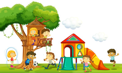 Children playing at the treehouse in the park
