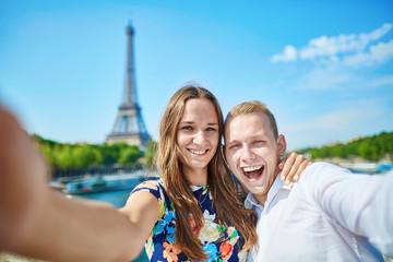 Romantic couple taking selfie in Paris