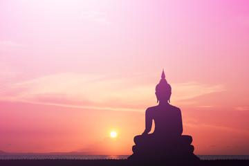 Buddha silhouette Sky background