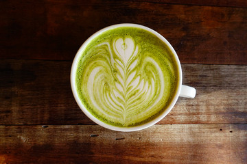 A cup of green tea matcha latte.