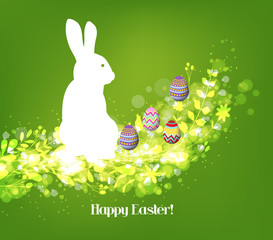 Happy easter eggs with fresh green leaves and rabbit