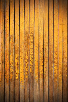 old, yellow wood panels used as background