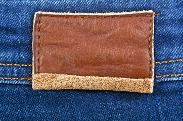 Leather jeans label sewed on jeans
