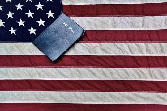 American Flag And Bible. The United States flag and a King James Bible.