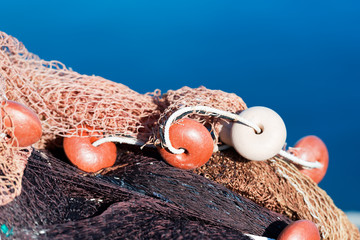 Detail of a Fishing Net / Close up of a fishing net with ropes and floats in the harbor