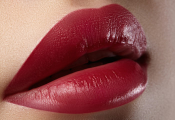 Close-up of woman's lips with fashion red make-up. Beautiful female mouth, full lips with perfect makeup. Classic visage. Part of female face. Macro shot of beautiful make up on full lips.