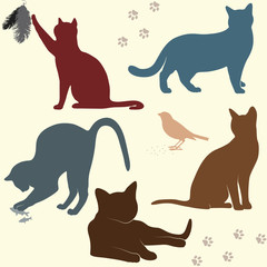 Vector set of funny cats silhouettes with bird, fish and feather.