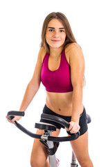 Girl trains on stationary bicycle