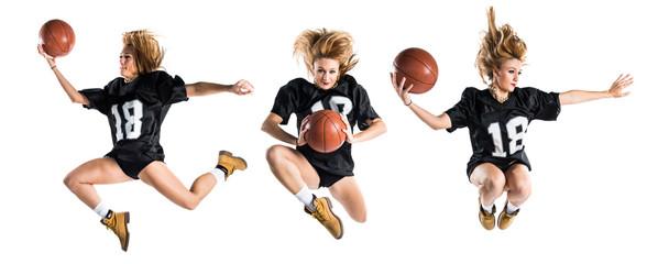 Woman jumping and playing basketball