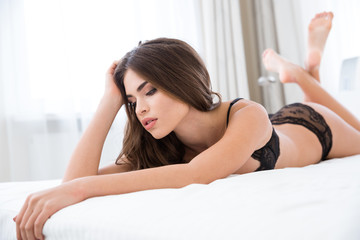Lovely woman lying on the bed