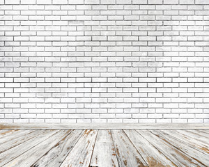 Empty room. White brick wall and wood floor.