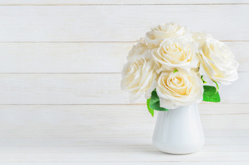 White artificial roses in vase
