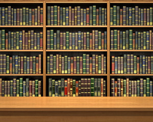 Table on background of bookshelf full of books . Old library.