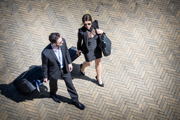 Business People Walking with Trolley Bag, Aerial View