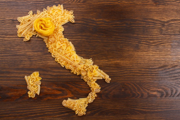 Italy made from pasta on the wooden background