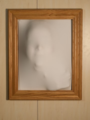 Creepy Picture Frame with Something Coming Out of It
