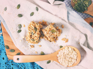 Oatmeal energy bars with oats, pumpkin seeds, peanut butter, agave syrup, sesame and sunflower seeds, top view