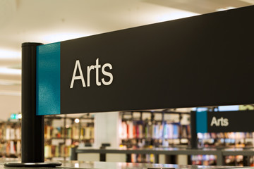 Arts section sign inside a modern public library