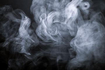 Smoke on a black background. Defocused. Toned