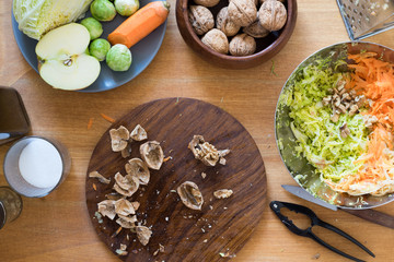 Cracked walnuts for cabbage, carrot and apple salad