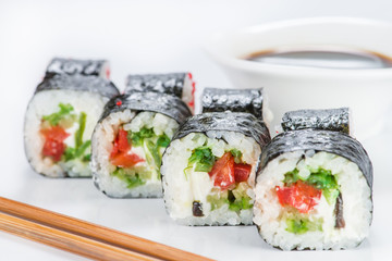 closeup roll sushi with chopsticks and soy sauce (shallow DOF)