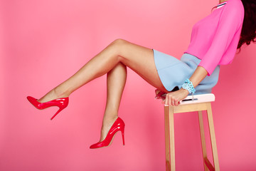 Female legs with red heels