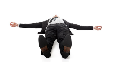 businessman lying on ground