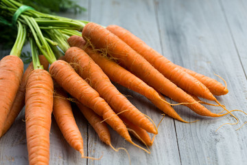 Fresh carrots bunch on wooden background