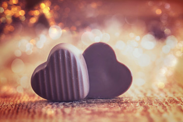 Two Chocolates Hearts on a wooden background,  valentines day.