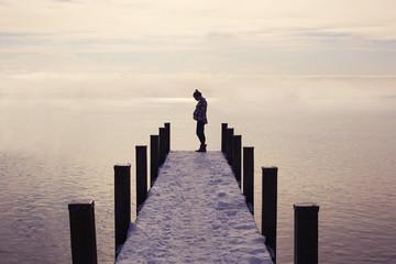 Pregnant woman on ocean pier