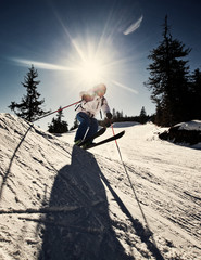 Man practicing extreme ski on sunny day
