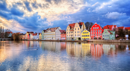 Colorful gothic houses reflecting in Isar river on sunset, Landshut, Germany