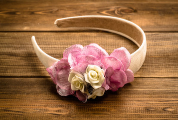 Vintage style headband with flowers on wooden background